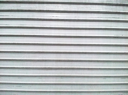 Gray steel garage door with horizontal lines photo
