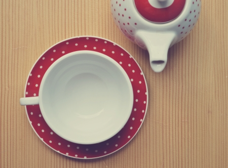 Red polka dot kettle and cup on wooden vintage Stock Photo - 22783389