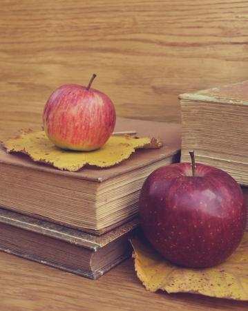 Vintage apples on books photo