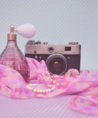 Old vintage camera with parfume photo