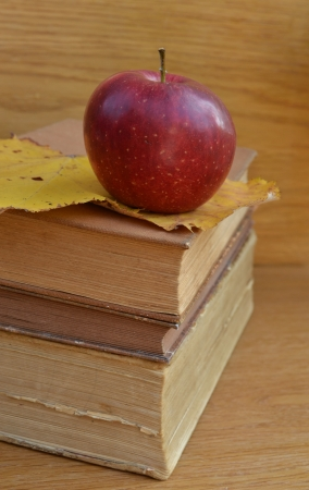 Red apple on old books photo