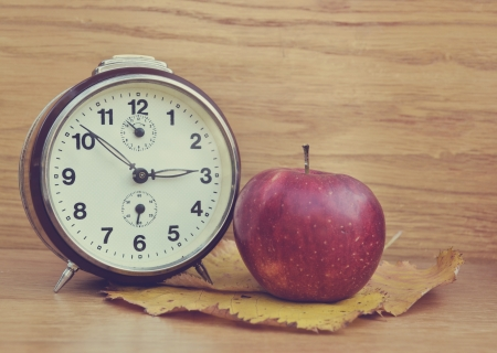 Vintage old clock and apple photo