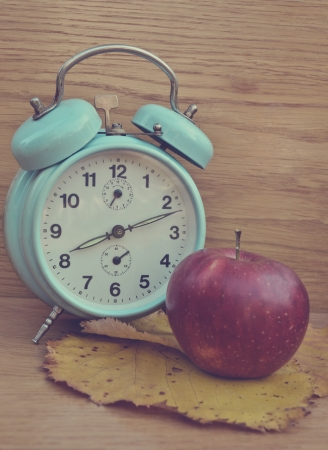 Vintage turquoise clock and apple photo
