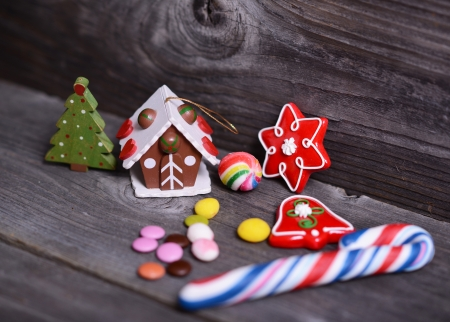 Small decorative house and christmas tree on wooden background photo