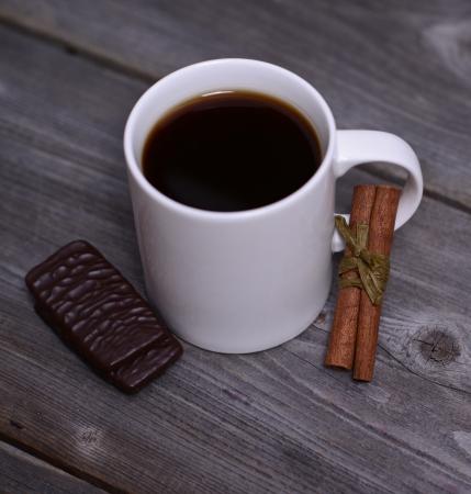 Mug of coffeek with cinnamon and chocolate photo