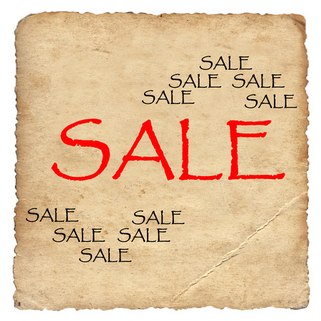 Sale on old paper background photo
