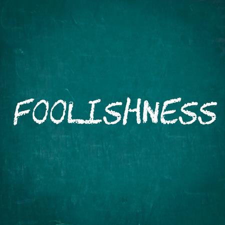 foolishness: FOOLISHNESS written on chalkboard