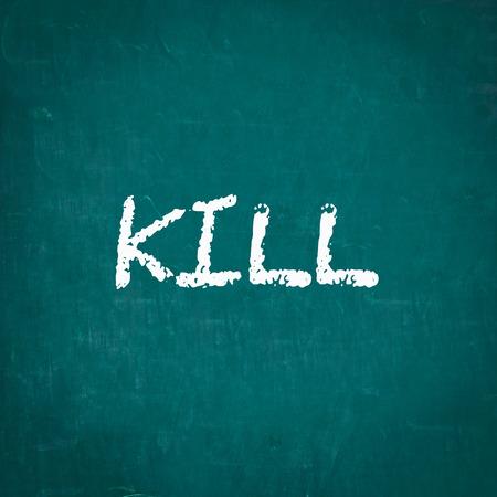 kill: KILL written on chalkboard Stock Photo