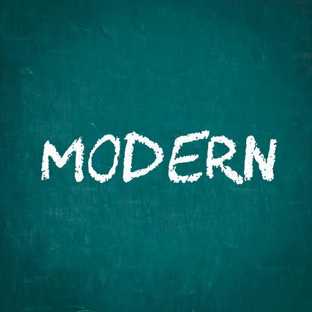 drawing up: MORERN written on chalkboard Stock Photo