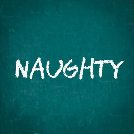 naughty: NAUGHTY written on chalkboard Stock Photo