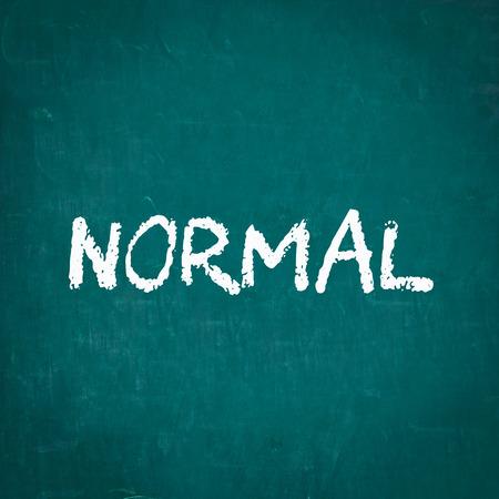 normal: NORMAL written on chalkboard