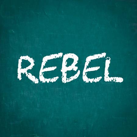 to rebel: REBEL written on chalkboard