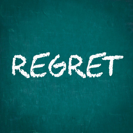 REGRET written on chalkboard