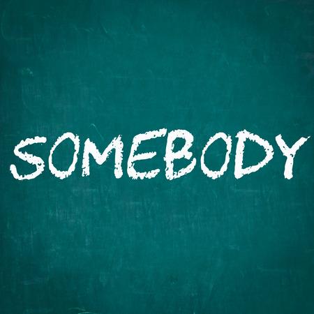 somebody: SOMEBODY written on chalkboard