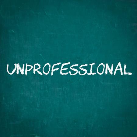 unprofessional: UNPROFESSIONAL written on chalkboard Stock Photo