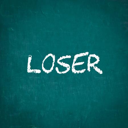 loser: LOSER written on chalkboard Stock Photo