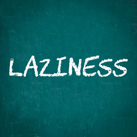 laziness: LAZINESS written on chalkboard Stock Photo