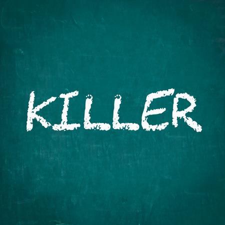 killer: KILLER written on chalkboard Stock Photo