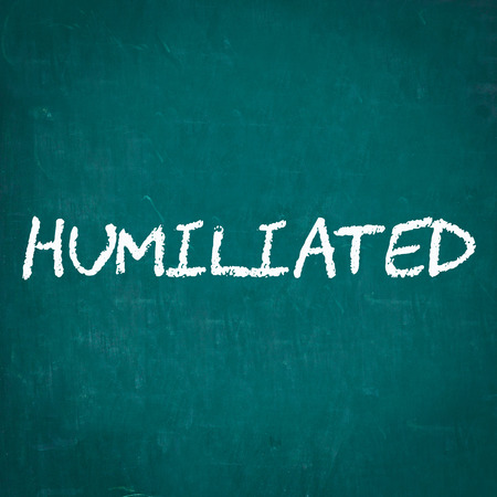 humiliated: HUMILIATED written on chalkboard
