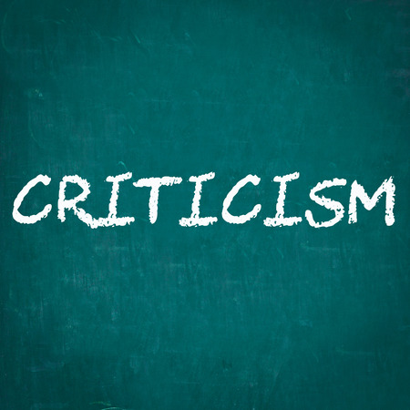 criticism: CRITICISM written on chalkboard Stock Photo