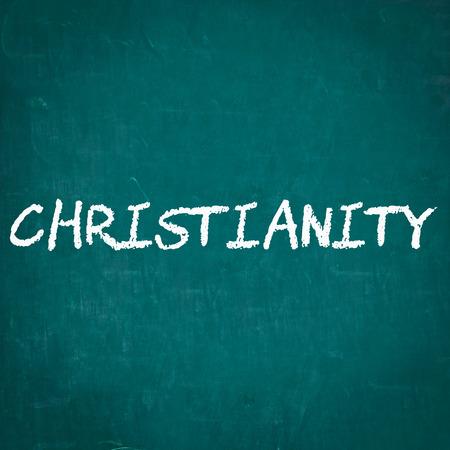 cristianismo: CRISTIANISMO escrita en la pizarra Foto de archivo