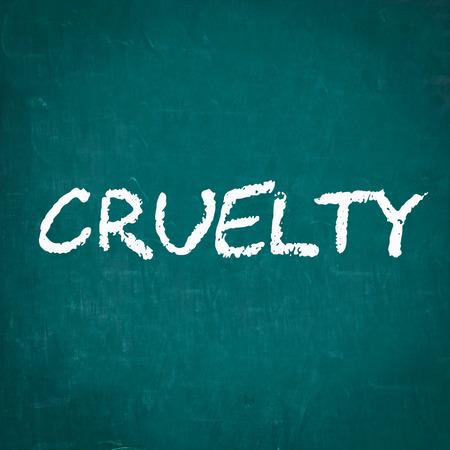 cruelty: CRUELTY written on chalkboard
