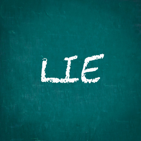 lie: LIE written on chalkboard