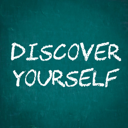 discover: DISCOVER YOURSELF written on chalkboard