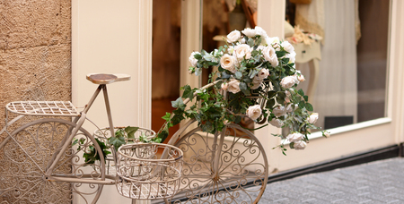 decorated bike: Beautiful white vintage bicycle with flowers