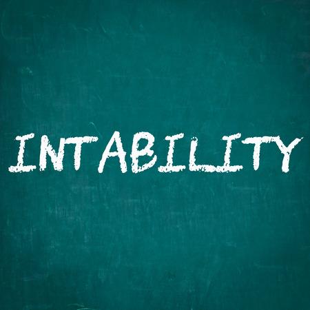 instability: INSTABILITY written on chalkboard