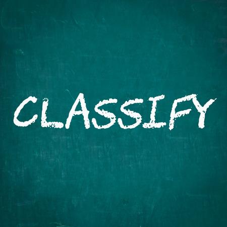 classify: CLASSIFY written on chalkboard