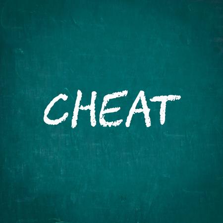 cheat: CHEAT written on chalkboard