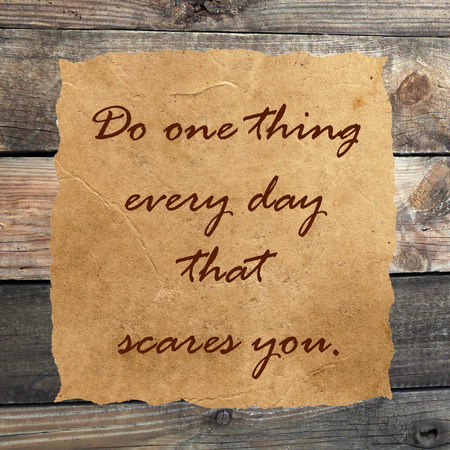 painterly: Inspirational quoteon  grunge paper against wood background Stock Photo