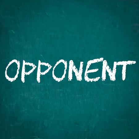 the opponent: OPPONENT written on chalkboard Stock Photo