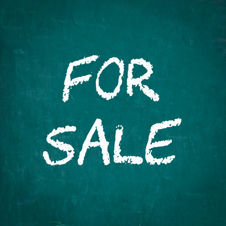 for: FOR SALE written on chalkboard Stock Photo
