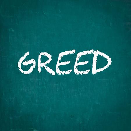 greed: GREED written on chalkboard Stock Photo