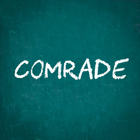 comrade: COMRADE written on chalkboard Stock Photo