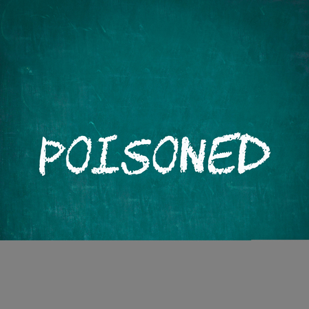 poisoned: POISONED written on chalkboard Stock Photo