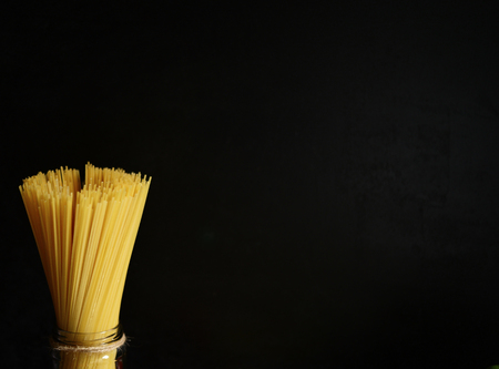 tomate: Bunch of spaghetti on blackboard with copy space Banque d'images