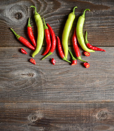 red chilly: Chilly pepper ( yellow and red ) on the wooden background Stock Photo