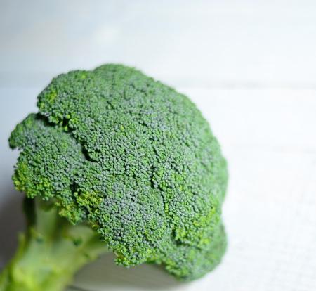 brocolli: Fresh brocolli on white table Stock Photo