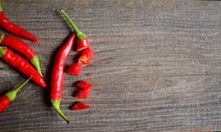 Chilly pepper on the old wooden table