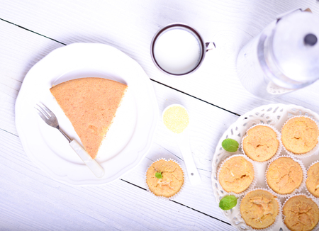 cornbread: Cornbread muffins and milk on white table