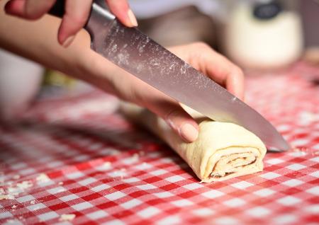 prepare: Woman prepare cinnamom rolls Stock Photo