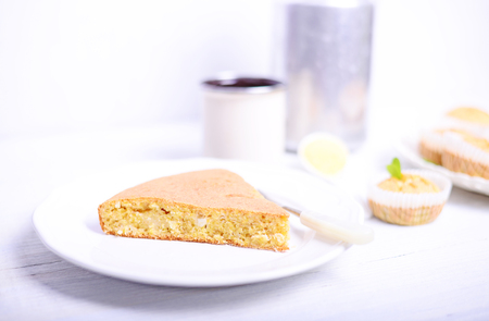 cornbread: Peace of cornbread on white table