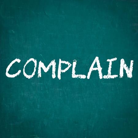 complain: COMPLAIN written on chalkboard