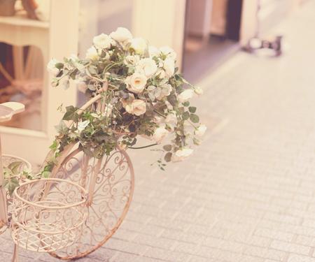 original bike: Beautiful vintage bicycle with flowers on street Stock Photo