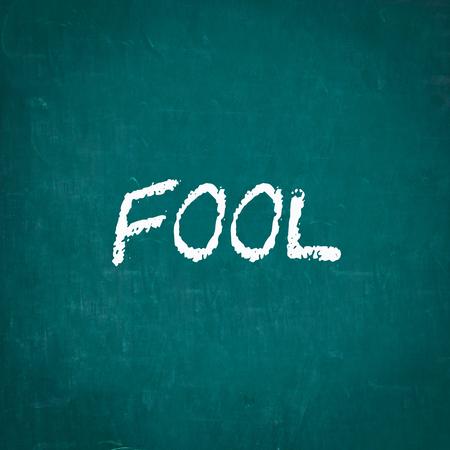 bobo: FOOL written on chalkboard Foto de archivo