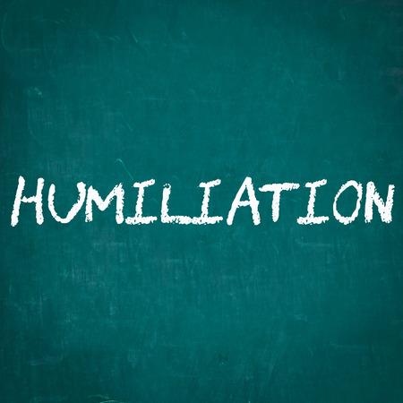humiliation: HUMILIATION written on chalkboard