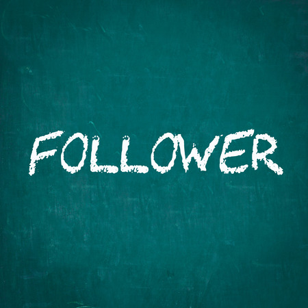 follower: FOLLOWER written on chalkboard